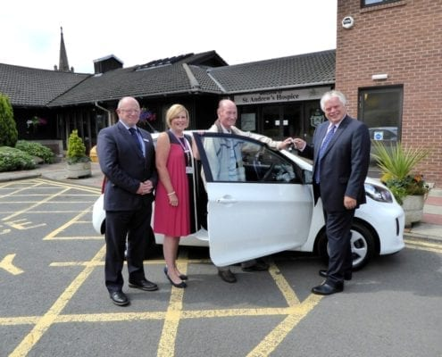 Grand Car Raffle winner collects prize