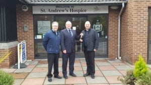 Joe Cairney (Chair of the Board, St Andrew's Hospice), Bruce High, handing over the Hospice keys to John Butler from CCG